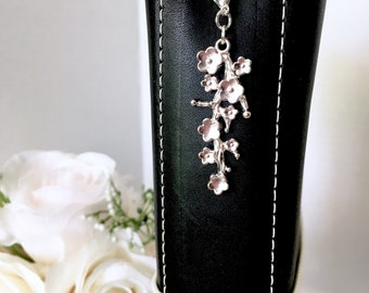 Beautiful vintage cherry blossom brushed metal planner charm from the Simply Vintage Collection