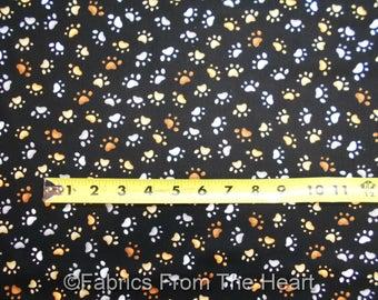 Hunde Hund Kitty Katzen Pfotenabdrücke Tan weiß auf schwarz von YARDS Loralie Stoff