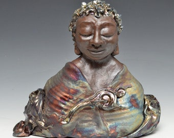 African Buddha in the Shimmering Clouds With Calm Peaceful Gaze Raku Ceramics