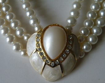 Faux pearl, enamel, rhinestone three strand necklace.