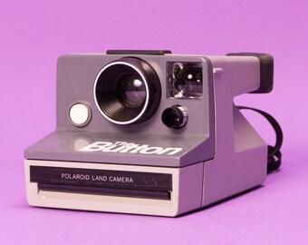"""Polaroid SX70 """"The Button"""" Instant Film Camera"""