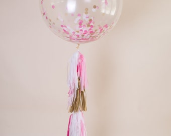 Confetti Balloon with Frill. Confetti tassel balloon with pink and gold tassel garland