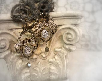 scapulaire one of a kind vintage assemblage earrings vintage french holy medals lady of mt carmel faceted pyrites