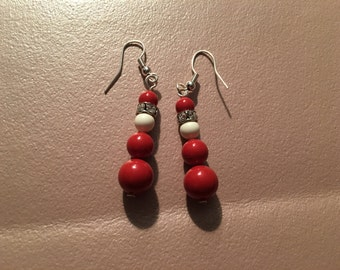 Earrings, dangle, beaded, red and white Santa Claus on sterling silver hooks.