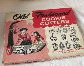 Set of 11  vintage cookie cutters in original box