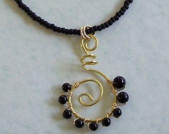 Brass Spiral Pendant with Black Onyx Wirewrap Pendant on Black Beaded Necklace by Carol Wilson of Je t'adorn