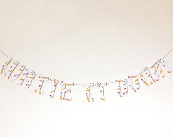 Write It Down banner on pencil patterned paper