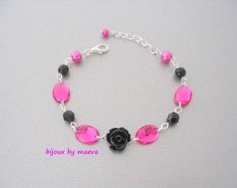 Costume jewelry rhinestone bracelet and fuchsia and black beads
