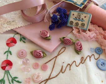 Vintage pink and blue haberdashery pack buttons flowers silk pieces wooden cotton reel ribbon ric rac snaps linen bag