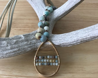 Boho style amazonite and gold oval wired pendant on a wire and bead necklace