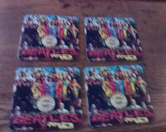 set of 4 brand new   Sgt. Pepper's Lonely Hearts Club Band  drink coasters