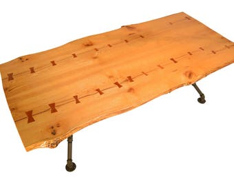 Live edge red oak dining table with highly detailed butterfly joints and industrial legs