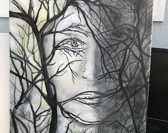 Woman face in trees