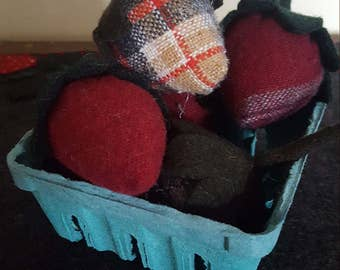 Wool strawberries in a berry box