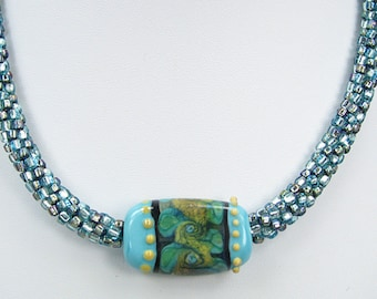 Handmade Beaded Kumihimo Necklace with Glass Lampwork Tab.   Blue Green