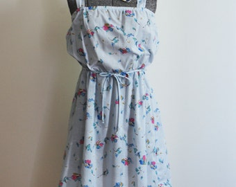 Baby blue, 1980s, floral, cotton blend sundress with A-line skirt. Size S to M.