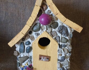 Stone and yellow birdhouse. Colorful and detailed. Outdoor protection.Hanging and easy clean. Fast shipping and handmade in Michigan.