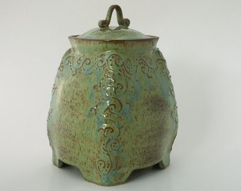 Green-blue-brown container with slip decoration