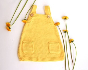 Knitted baby dress in wool alpaca blend, available in many colors