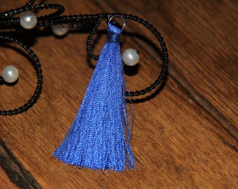 The large blue tassel tassel with silver plated ring