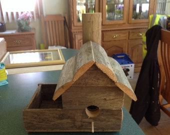 Birdhouse rustic with planter reclaimed wood fencing