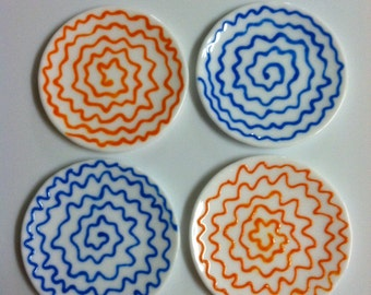 Set of four glass appetizer plates