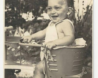 Vintage BW photo of young kid in toy car / carriage