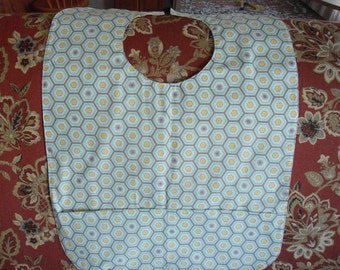 Adult Bib with gray,white,green design on one side, navy and tan on one side.