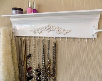 "White Jewelry Organizer w/ shelf and 2 swing out arms great for scarves or tons more necklaces.15 hooks on the bottom   20"" necklace holder"