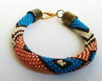 Ethnic seed bead crochet bracelet with geometrical pattern. Multicolor jewelry. Seed beads bracelet. Beadwork bracelet. Beaded rope