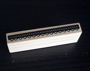 Scallop border rubber stamp