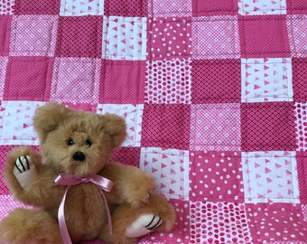 Pink patchwork quilt for baby girl