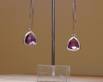 Purple faceted glass on long silver rhodium plated ear wires