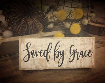Distressed wood block sign with vinyl