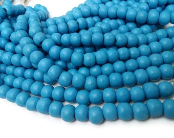 Perles rondes en bois bleu pastel 10x9mm - 30 unités