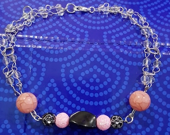 Black and pink beaded and link chain bracelet