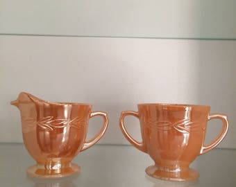 Fire king peach lustre ware cream mil and sugar bowls pitchers laurel