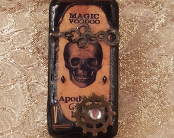 Domino Voodoo Magic  magnet, because, refrigerators are nice to us.  We should,  at the very least, dress them well.