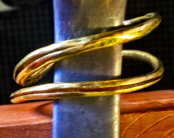 Raised 22k bangles by ann biederman