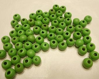 70 green wood beads, 8 mm (B9)