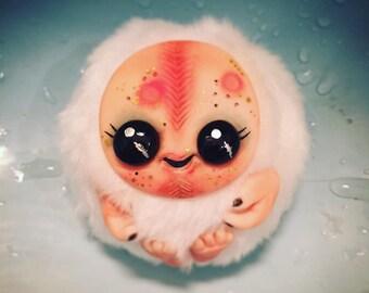 Smiling white Monster Christmas ornament