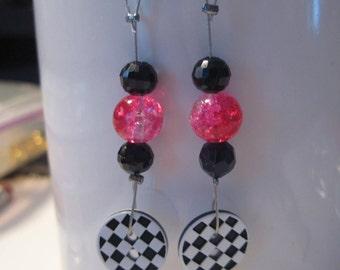 earrings, black and pink.