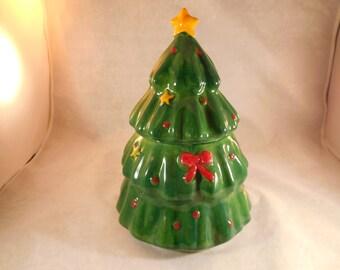 Christmas tree cookie jar made of ceramic.
