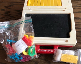 1990 Fisher-Price chalkboard and magnetic board with the entire alphabet except missing the J