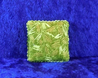 Dollhouse Miniature accessory in twelfth scale or 1:12 scale; Decorative pillow.  Item #501.