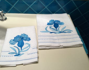 Pair of stylized flower towels