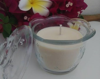 Pink Magnolia Blossom soy candle in a glass container.