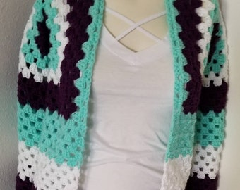 Purple, Mint, and White cardigan sweater with long sleeves.