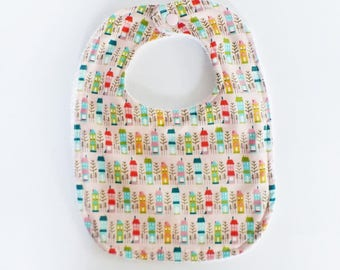 """Pink pattern """"Little houses Pastels"""" and white Terry bib baby 0-9 months"""