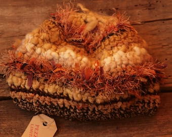 Hat made of wool and mixed yarns made with unique crochet technique